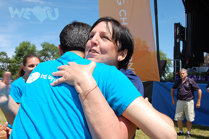 WeLoveU volunteers cheer on participants of the Special Olympics