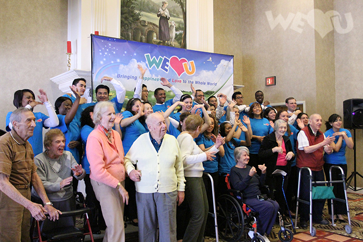 WeLoveU volunteers take a group photo with Care One residents