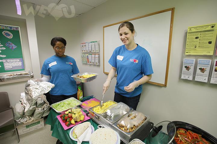 WeLoveU volunteers prepare nutritious meals
