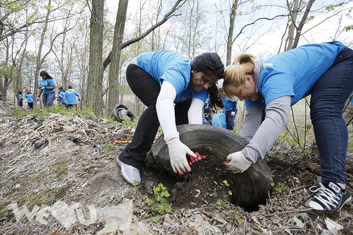 WeLoveU volunteers clean Overpeck Park