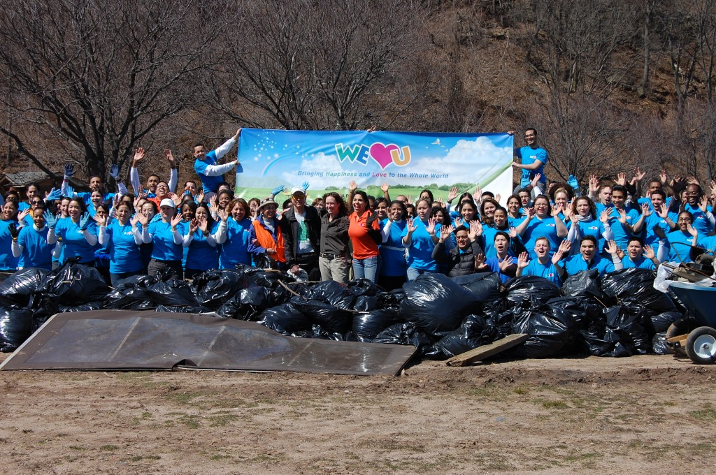 150 WeLoveU volunteers gather with the trash they removed from the park, beaches and surrounding roads.