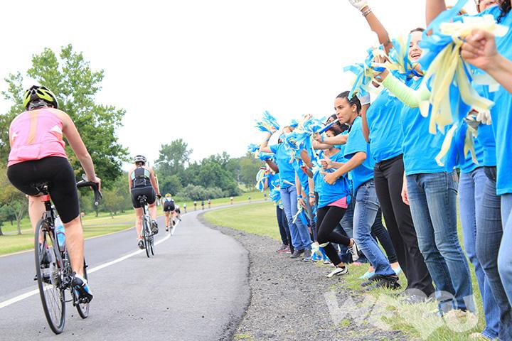 WeLoveU blue shirted volunteers line the bike path