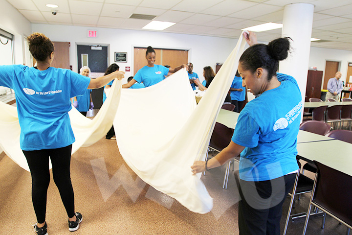 WeLoveU volunteers clean up after serving lunch