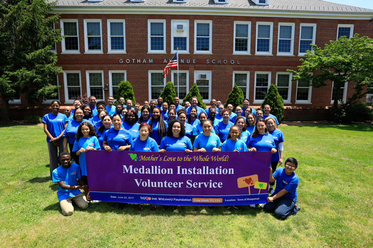 WeLoveU volunteers mark storm drains in Long Island, NY.