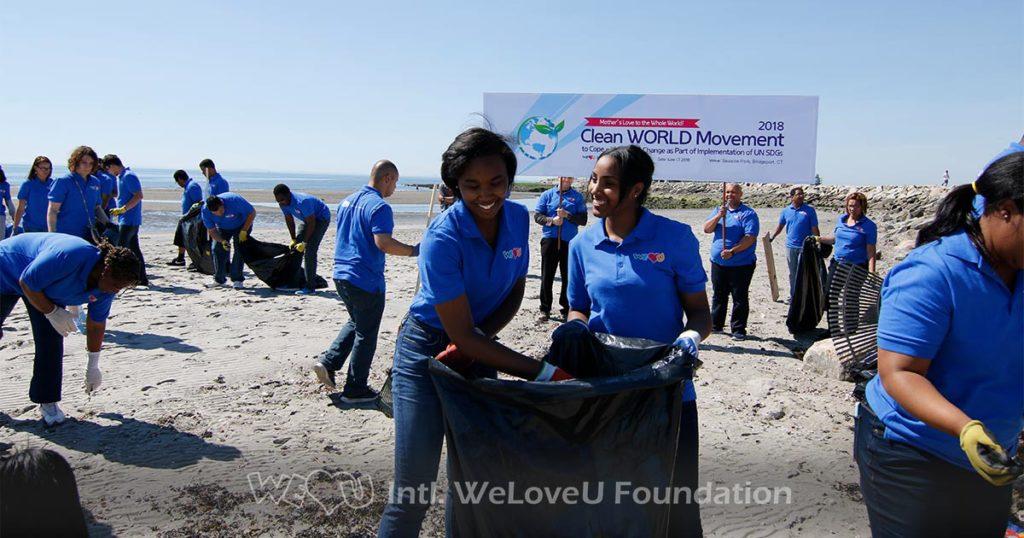 WeLoveU volunteers clean Seaside Park in Bridgeport, CT.