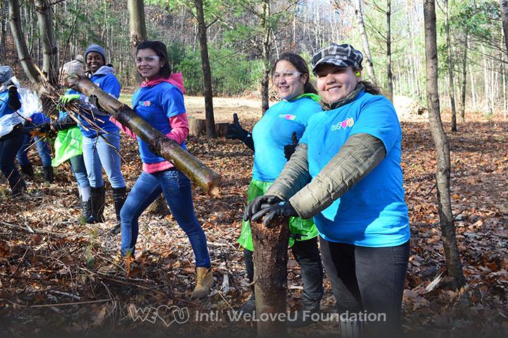 WeLoveU volunteers clean Barrett Park in Massachusetts.