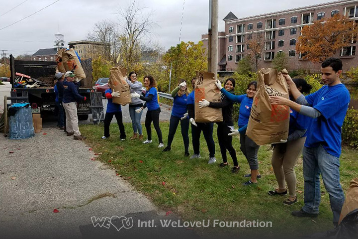 WeLoveU volunteers clean Library Walk in Nashua, NH.