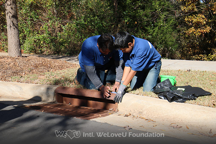 WeLoveU volunteers mark storm drains in Huntersville.