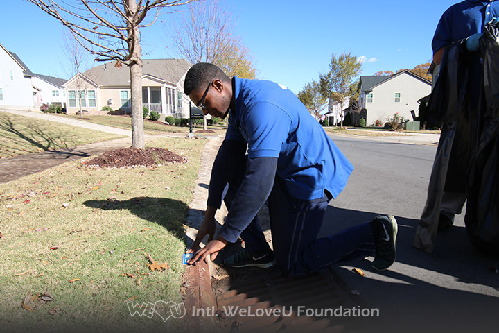 WeLoveU volunteers mark storm drains in Huntersville.
