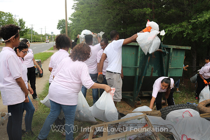 WeLoveU volunteers clean Nations Ford Road in Charlotte, NC.