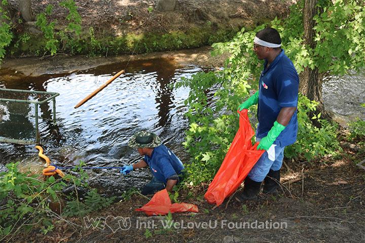 WeLoveU volunteers clean Fayetteville's Cross Creek.
