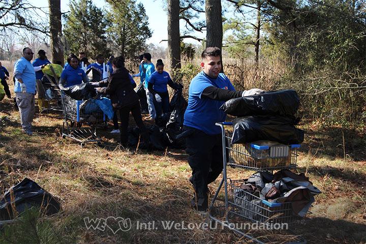 WeLoveU volunteers clean Central Park in Newport News, VA.