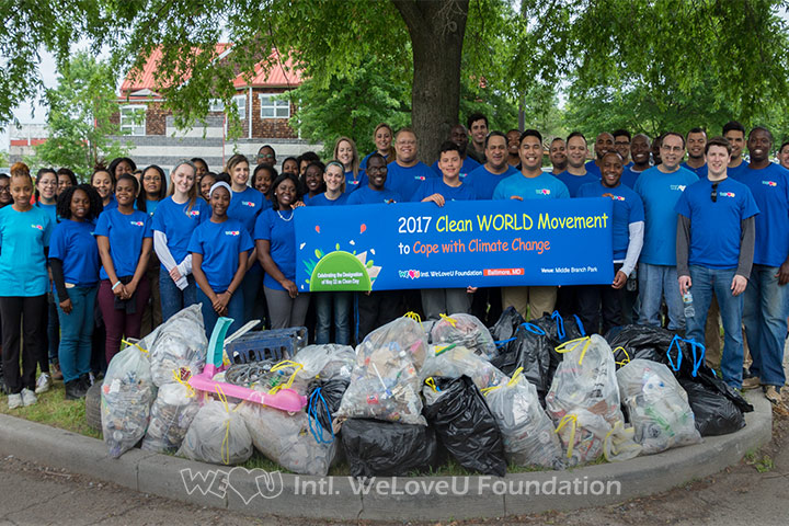 WeLoveU volunteers clean Middle Branch Park in Baltimore.