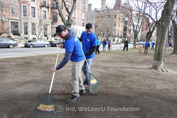 WeLoveU volunteers clean Commonwealth Avenue Mall in Boston, MA.