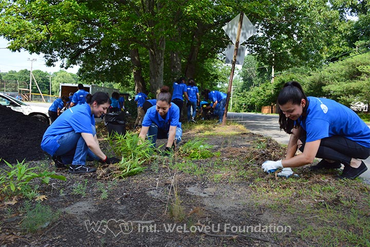 WeLoveU volunteers carry out a cleanup in Fournier Park in Leominster, MA.