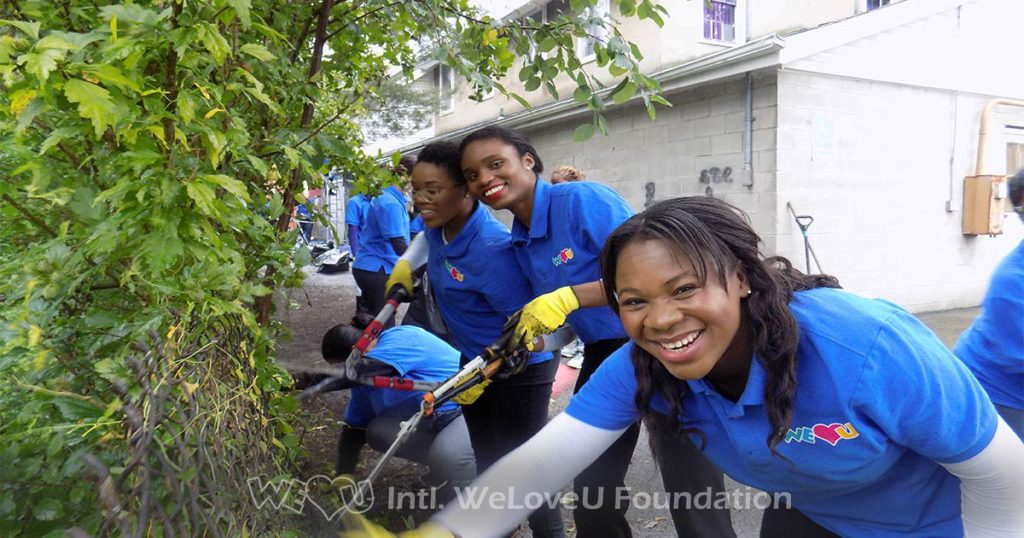 WeLoveU volunteers remove graffiti in Lockport, NY