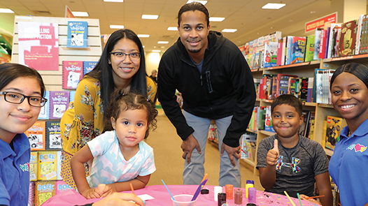 A family in Barnes & Noble donates to WeLoveU's book drive.