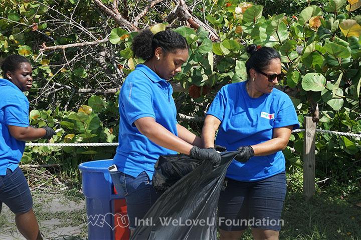 WeLoveU volunteers clean Virginia Key Beach Park in Florida.