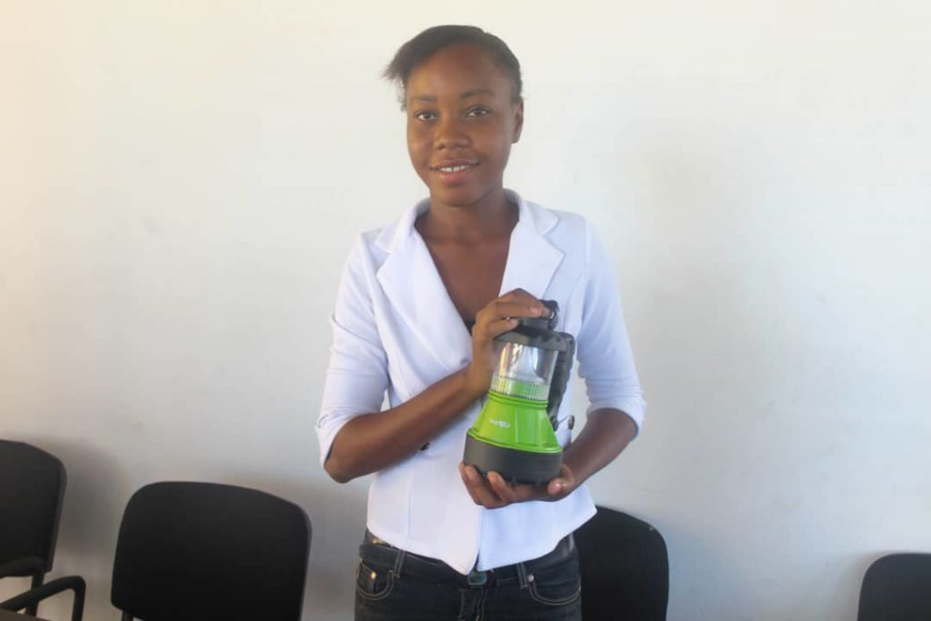 A student holds a lantern