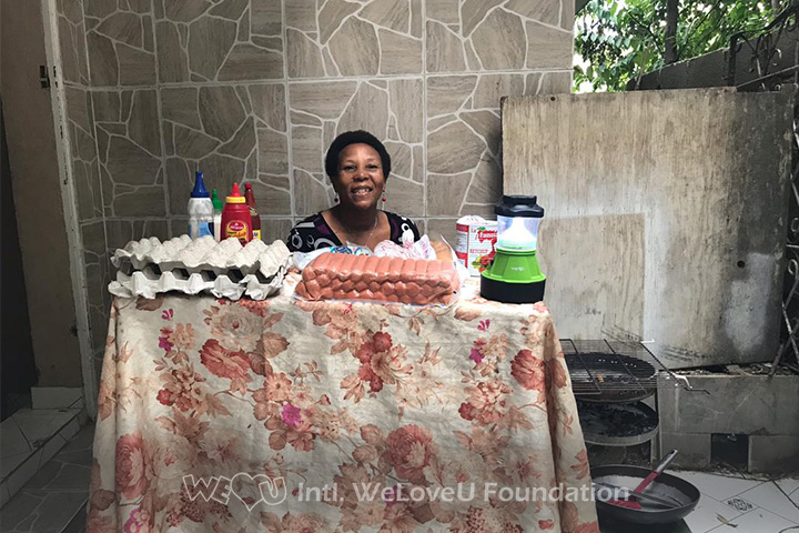 A woman conducts her side business with the lantern
