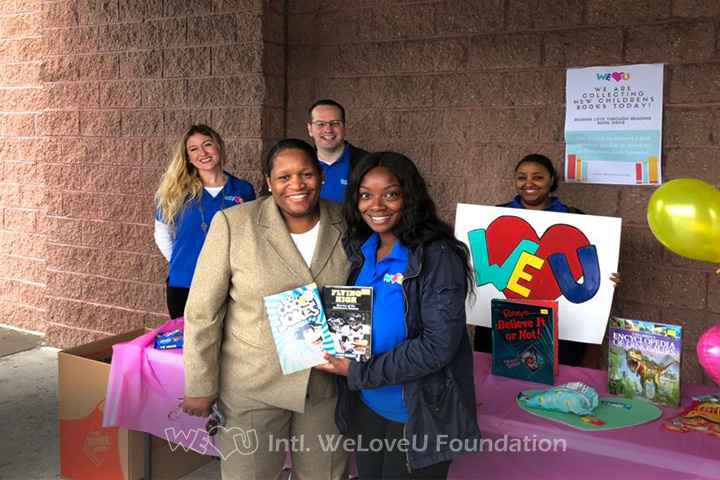 Local residents donate to WeLoveU's book drive for Christiana Care.