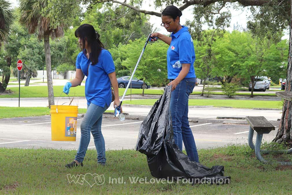 WeLoveU volunteers clean Tradewinds Park Stables in Florida.