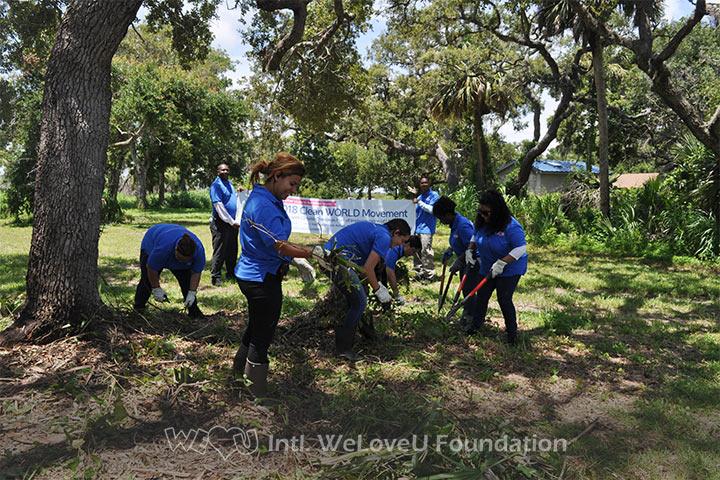 WeLoveU volunteers clean the Sendler Education Outpost.