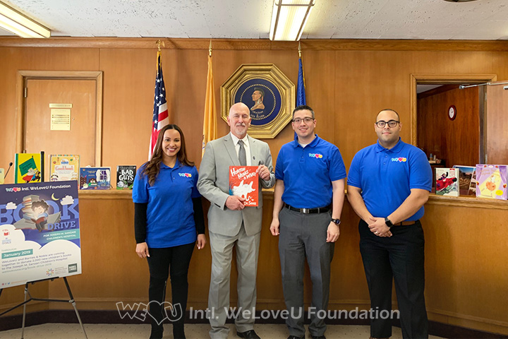 Mayor John Labrosse of Hackensack donates to WeLoveU's book drive