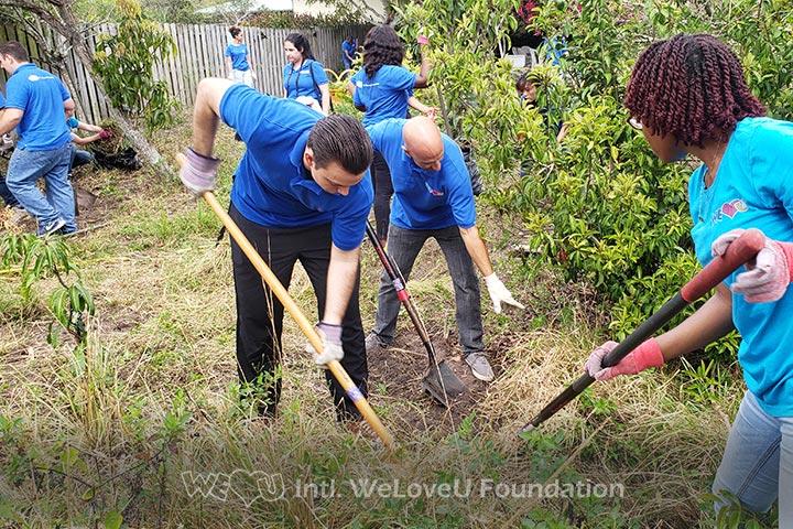 WeLoveU volunteers plowing the ground
