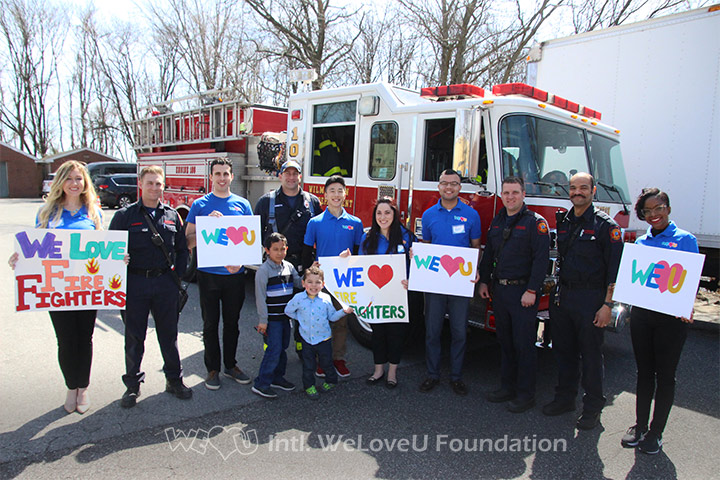 Local firefighters take photo with WeLoveU volunteers
