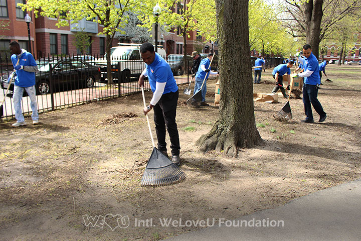 Raking leaves in Boston's Blackstone and Franklin Square on Earth Day