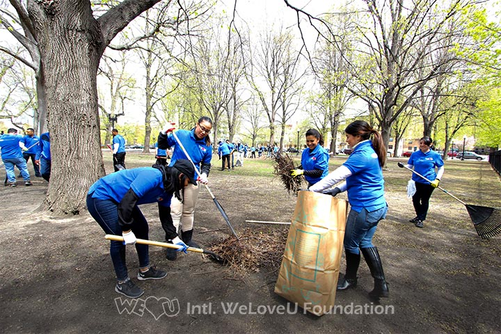 Volunteers work together to rake up the leaves at Blackstone and Franklin Square.