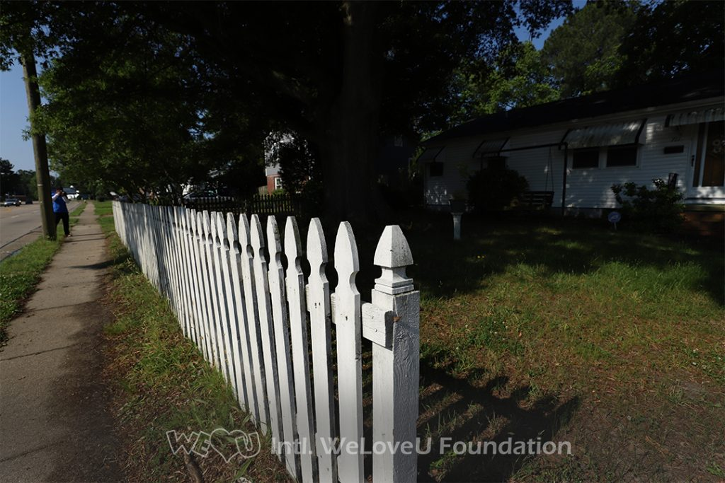Ms. Monroe's fence before WeLoveU volunteers arrived