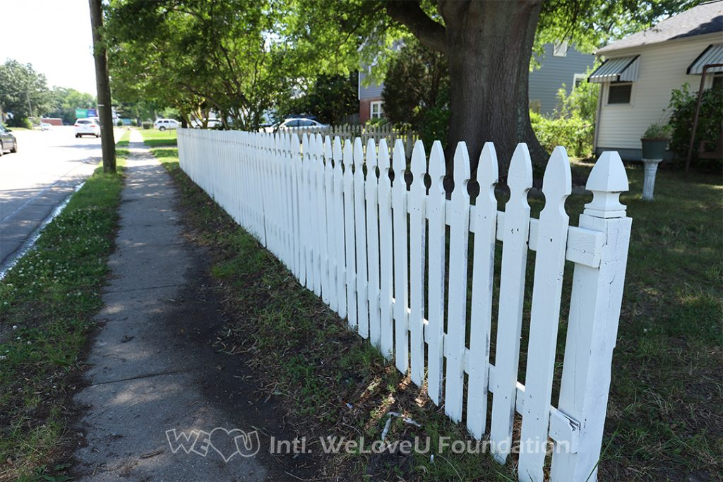 Ms. Monroe's fence after volunteers painted it