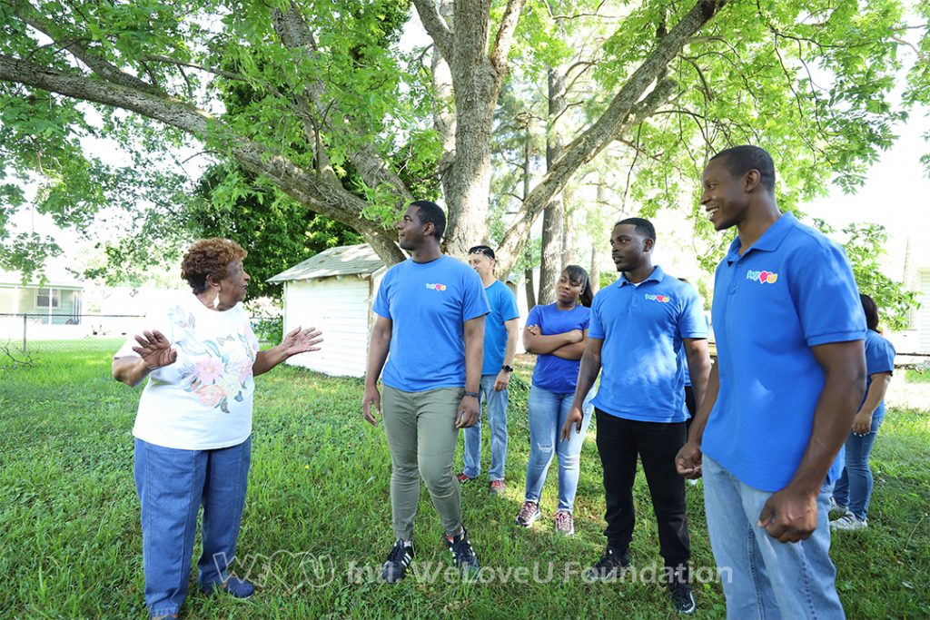 Ms. Monroe showing volunteers around her home
