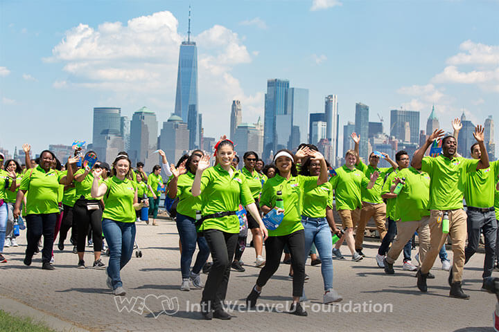Happy participants walking in support of Mozambique at WeLoveU's 23rd New Life Family Walkathon.
