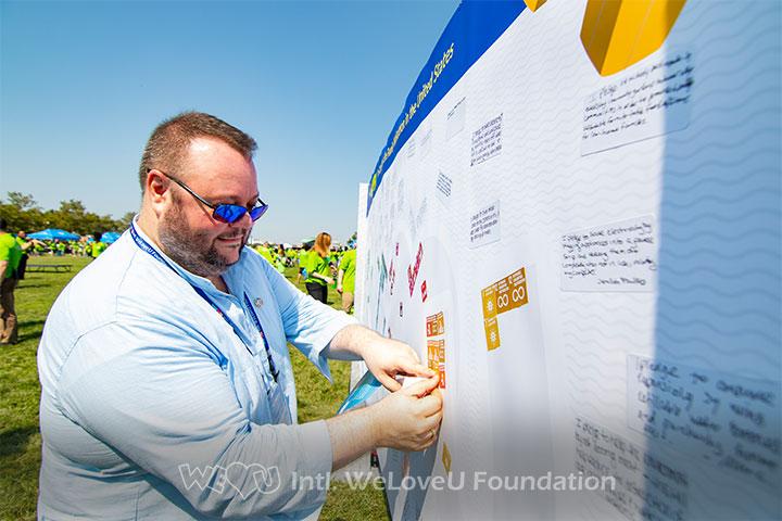 UN-DGC-Representative-Felipe-Queipo-at-the-WeLoveU-Activity-Booth