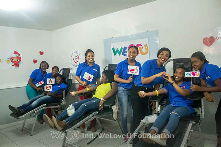 Volunteers in Haiti participating in WeLoveU's blood drive.