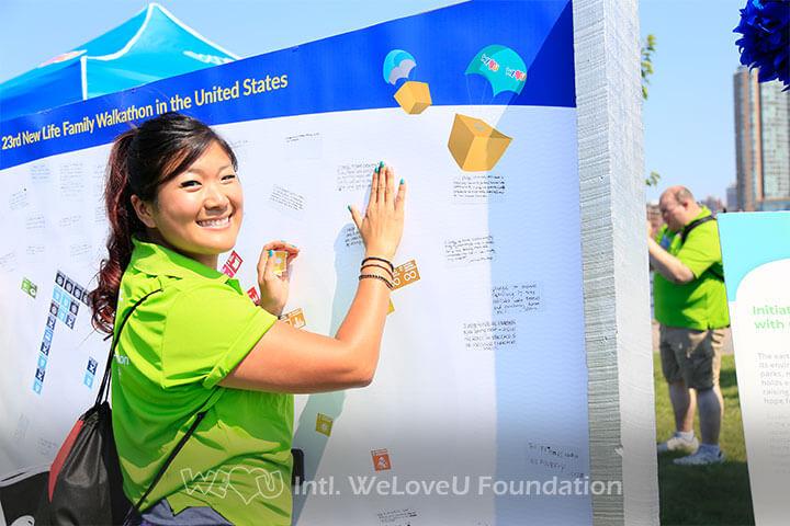 A WeLoveU walkathon participant at the SDG activity booth.