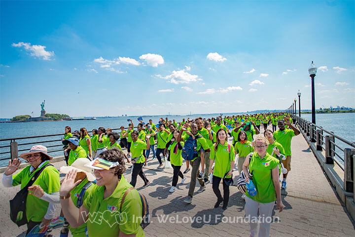 WeLoveU volunteers walking along the Hudson River at the 23rd New Life Family Walkathon.