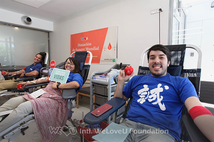 Three blood donors at WeLoveU's Worldwide Blood Drive Movement