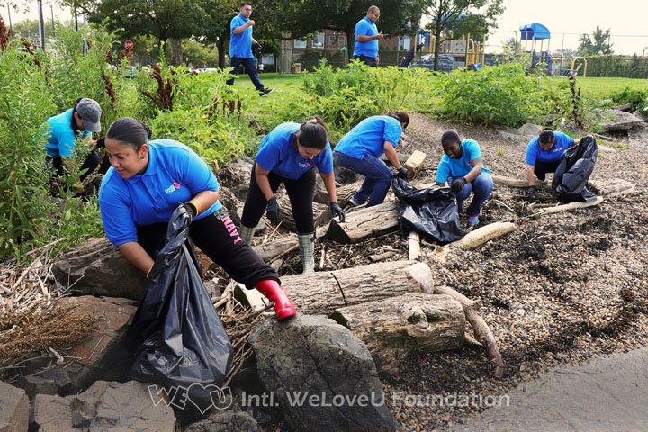 Working together, picking up trash, Newark Bay Shoreline