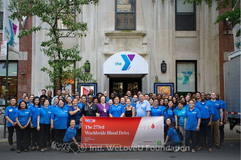Group photo outside the YMCA in New York City for WeLoveU's 2019 Worldwide One-Two Blood Drive Movement