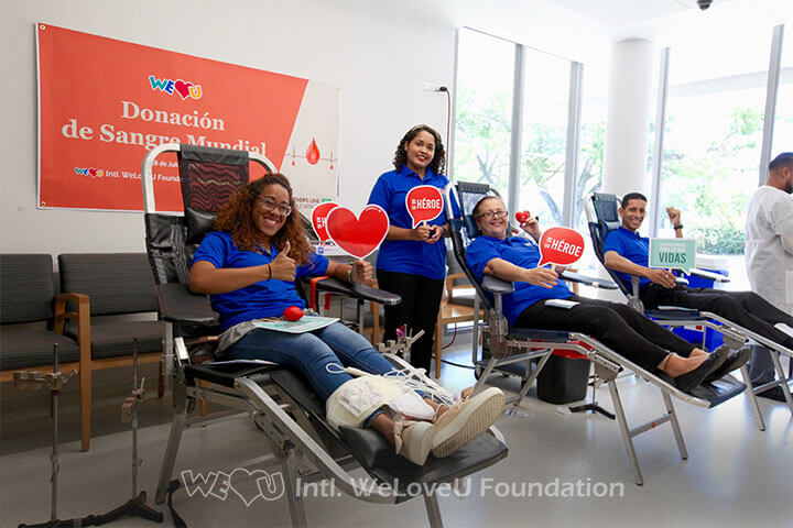 Happy volunteers participating in WeLoveU's blood drive in Puerto Rico