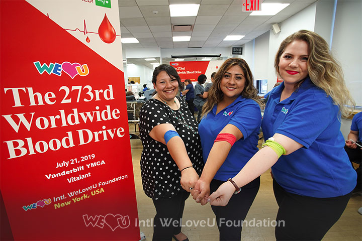 Three WeLoveU volunteers proudly showing their bandages after donating.
