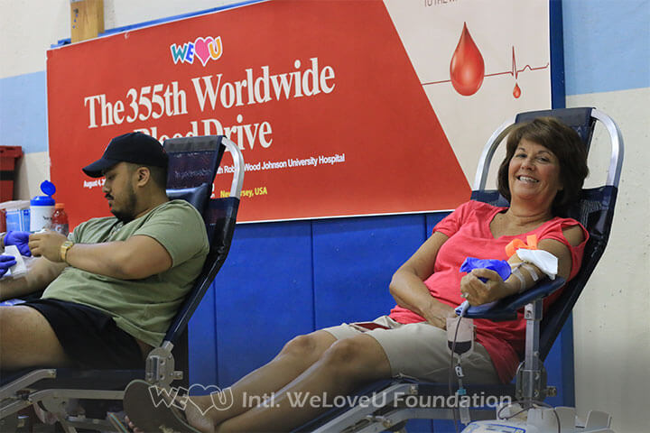 residents participating in WeLoveU's blood drive