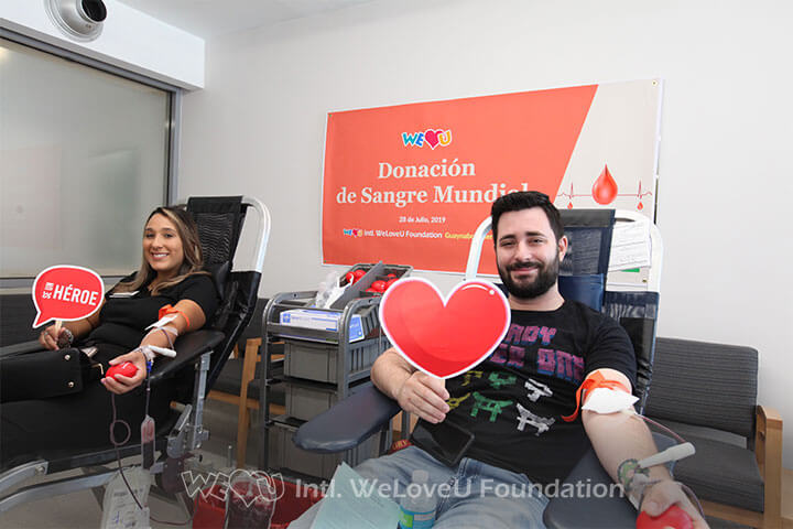 Two local resident participating in WeLoveU's 2019 Worldwide Blood Drive Movement in Puerto Rico