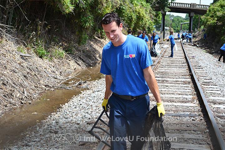 WeLoveU volunteers clean Railroad Avenue in Durham, NC.