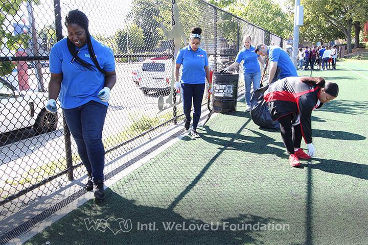 WeLoveU volunteers with State Rep Liz Miranda cleaning