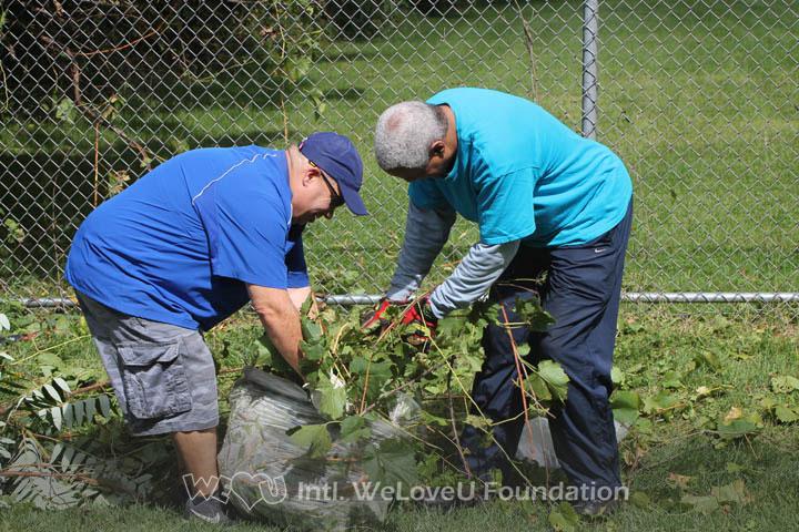 Weed removal with WeLoveU volunteers in Syracuse